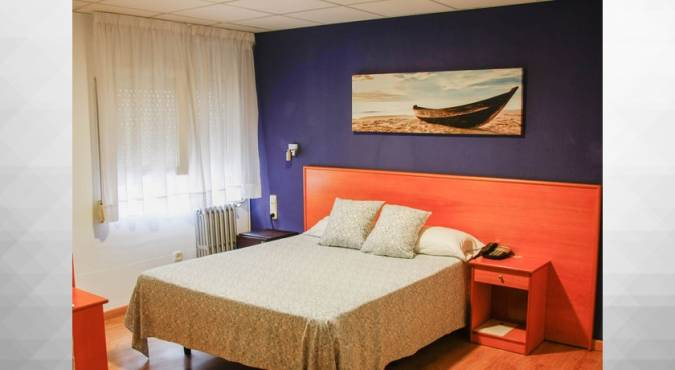 Habitación del Hotel La Perla, en Almería
